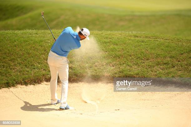 Dustin Johnson plays a shot from a bunker on the 1st hole during the final match of the World Golf Championships-Dell Technologies Match Play at the...