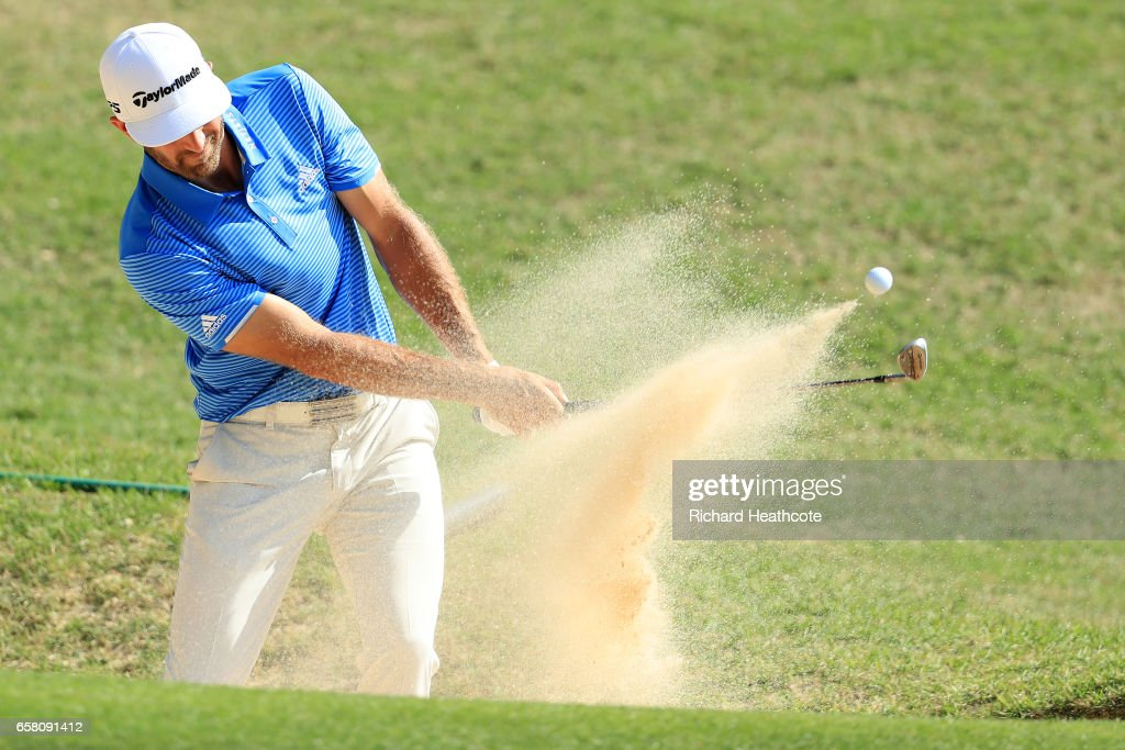 Dustin Johnson plays a shot from a bunker on the 9th hole during the final match of the World Golf Championships-Dell Technologies Match Play at the Austin Country Club on March 26, 2017 in Austin, Texas.