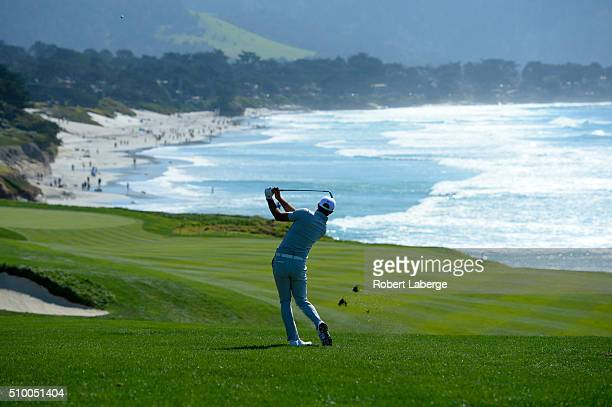 Dustin Johnson plays a shot from the ninth fairway during round three of the ATT Pebble Beach National ProAm at the Pebble Beach Golf Links on...