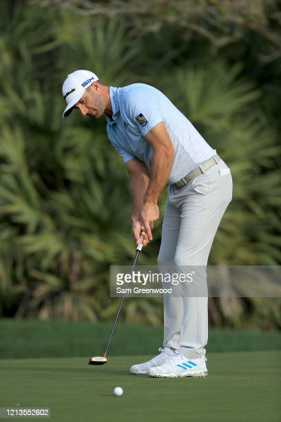 Dustin Johnson plays a shot on the 10th hole during the first round of The PLAYERS at the TPC Stadium course on March 12 2020 in Ponte Vedra Beach...