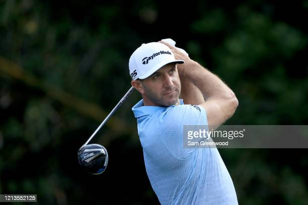 Dustin Johnson plays a shot on the 11th hole during the first round of The PLAYERS at the TPC Stadium course on March 12 2020 in Ponte Vedra Beach...