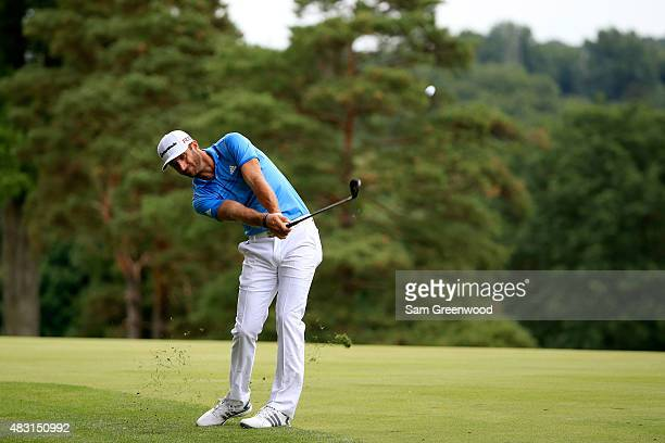 Dustin Johnson plays a shot on the 11th hole during the first round of the World Golf Championships - Bridgestone Invitational at Firestone Country...
