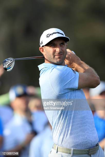 Dustin Johnson plays a shot on the 12th hole during the first round of The PLAYERS at the TPC Stadium course on March 12 2020 in Ponte Vedra Beach...