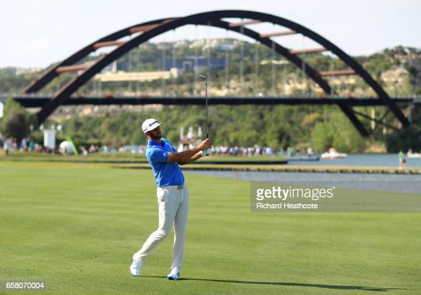 Dustin Johnson plays a shot on the 13th hole during the final match of the World Golf Championships-Dell Technologies Match Play at the Austin...