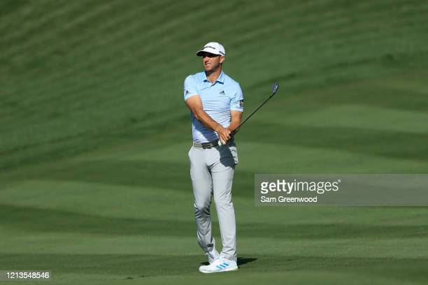 Dustin Johnson plays a shot on the 16th hole during the first round of The PLAYERS at the TPC Stadium course on March 12 2020 in Ponte Vedra Beach...