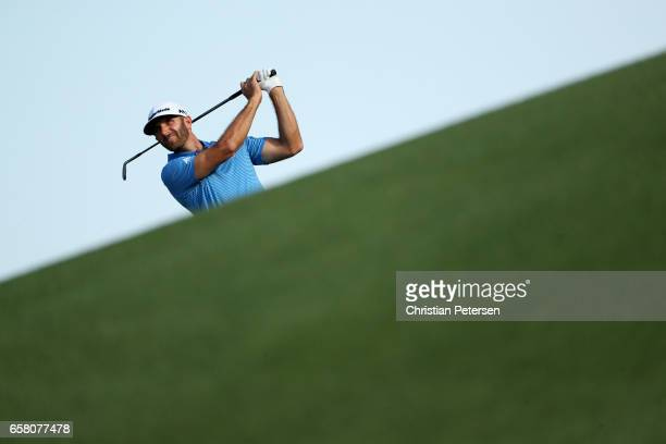 Dustin Johnson plays a shot on the 18th hole during the final match of the World Golf ChampionshipsDell Technologies Match Play at the Austin Country...