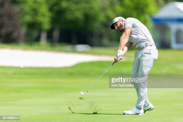 Dustin Johnson plays a shot on the fairway of the 9th hole during final round action of the RBC Canadian Open on July 30 at Glen Abbey Golf Club in...