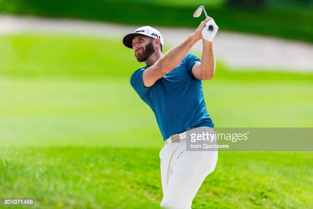 Dustin Johnson plays a shot out of the rough on the 18th hole during third round action of the RBC Canadian Open on July 29 at Glen Abbey Golf Club...