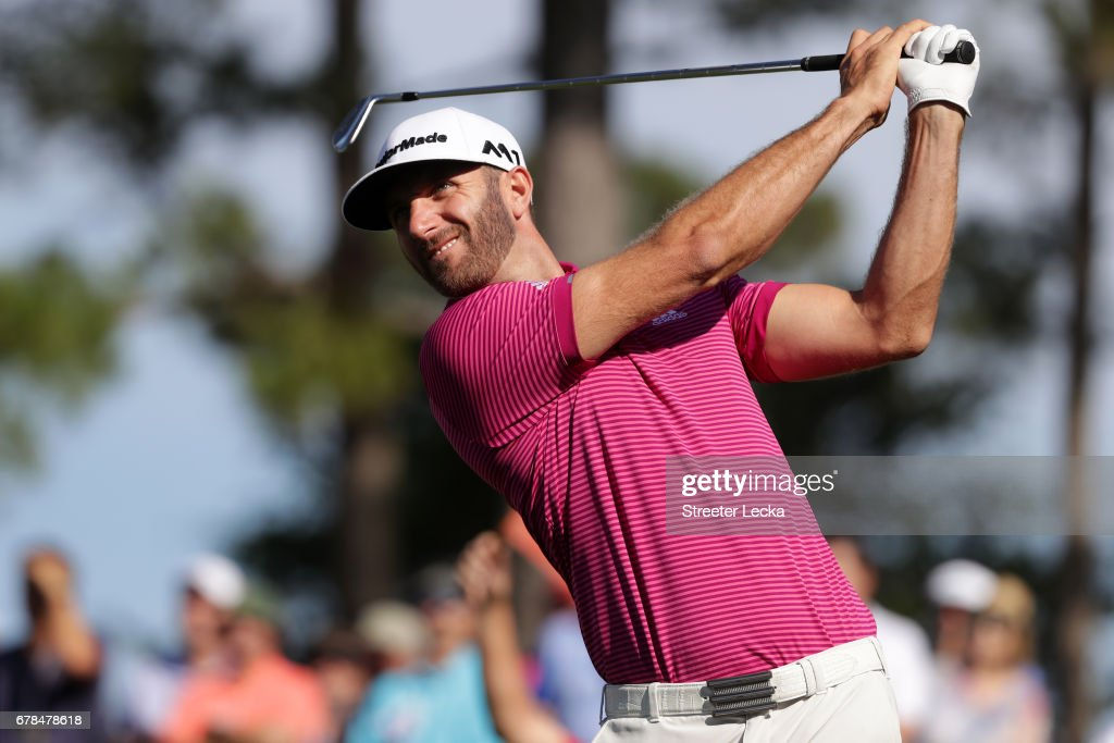 Dustin Johnson plays an approach shot on the 12th hole during round one of the Wells Fargo Championship at Eagle Point Golf Club on May 4, 2017 in Wilmington, North Carolina.