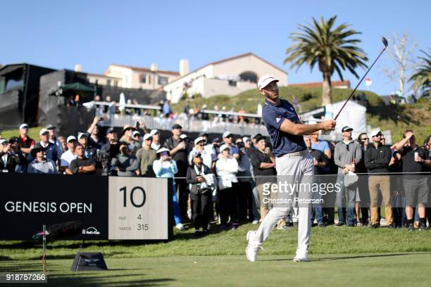 Dustin Johnson plays his shot from the 10th tee during the first round of the Genesis Open at Riviera Country Club on February 15 2018 in Pacific...