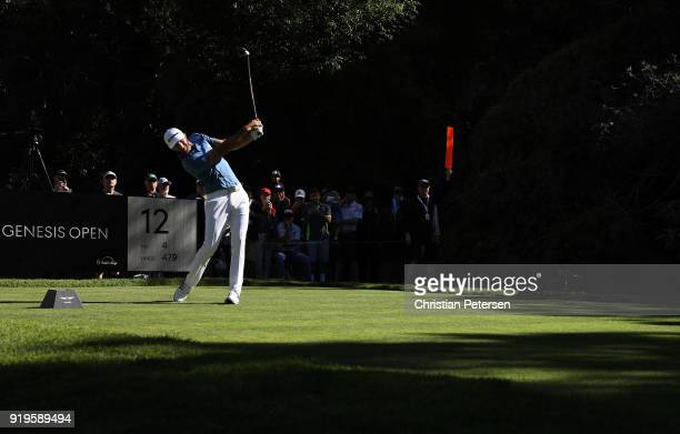 Dustin Johnson plays his shot from the 12th tee during the third round of the Genesis Open at Riviera Country Club on February 17 2018 in Pacific...