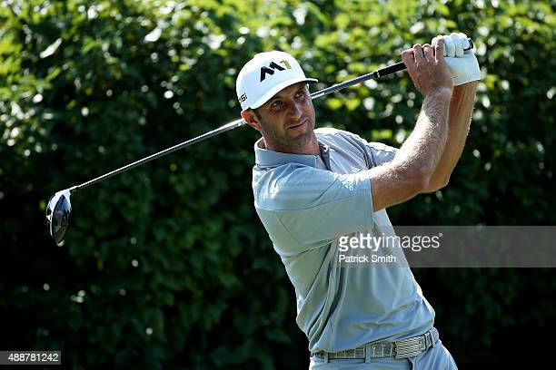 Dustin Johnson plays his shot from the 13th tee during the First Round of the BMW Championship at Conway Farms Golf Club on September 17 2015 in Lake...