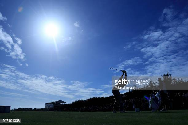 Dustin Johnson plays his shot from the 17th tee during the Final Round of the ATT Pebble Beach ProAm at Pebble Beach Golf Links on February 11 2018...