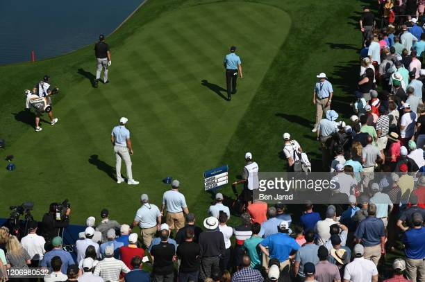 Dustin Johnson plays his shot from the 18th tee during the first round of THE PLAYERS Championship on THE PLAYERS Stadium Course at TPC Sawgrass on...