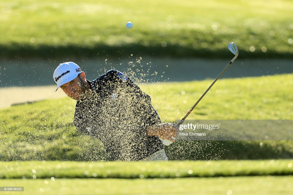 Dustin Johnson plays his shot from the bunker on the first hole during Round One of the AT&T Pebble Beach Pro-Am at Spyglass Hill Golf Course on February 8, 2018 in Pebble Beach, California.