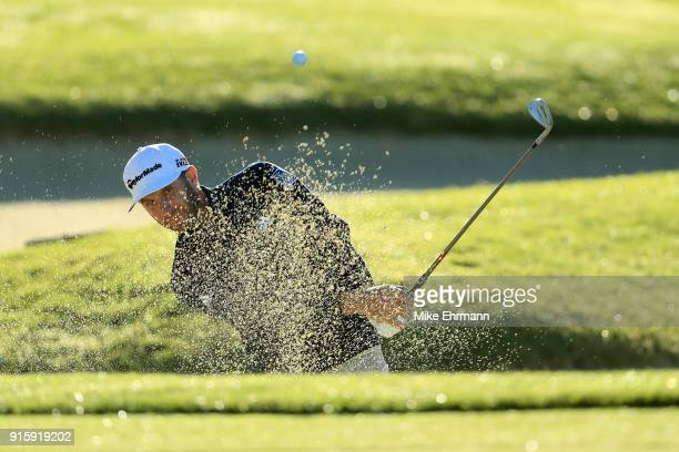 Dustin Johnson plays his shot from the bunker on the first hole during Round One of the ATT Pebble Beach ProAm at Spyglass Hill Golf Course on...