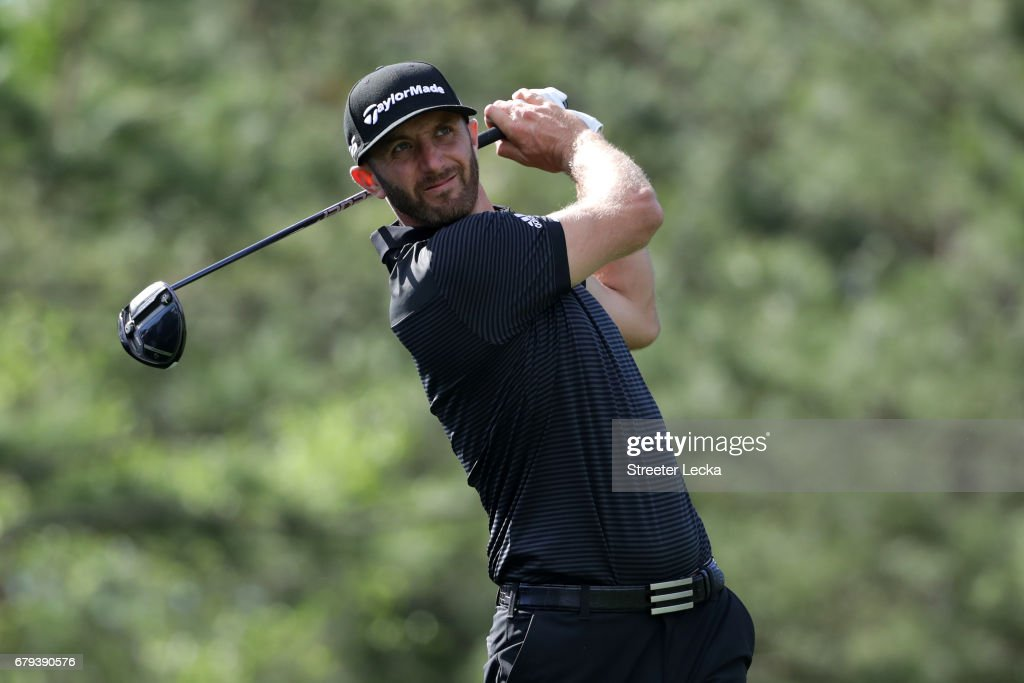 Dustin Johnson plays his shot from the fourth tee during round two of the Wells Fargo Championship at Eagle Point Golf Club on May 5, 2017 in Wilmington, North Carolina.