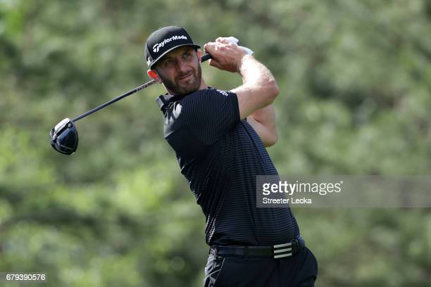 Dustin Johnson plays his shot from the fourth tee during round two of the Wells Fargo Championship at Eagle Point Golf Club on May 5 2017 in...