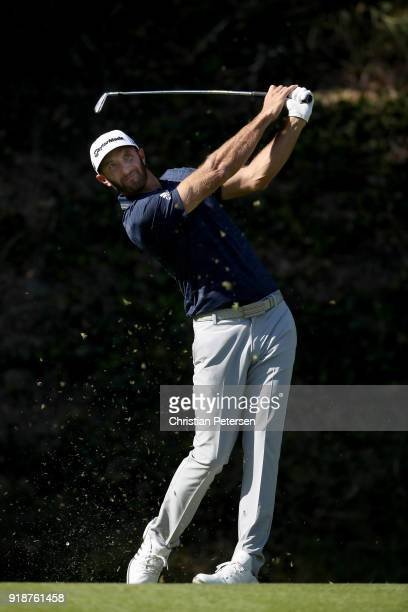 Dustin Johnson plays his shot from the sixth tee during the first round of the Genesis Open at Riviera Country Club on February 15 2018 in Pacific...