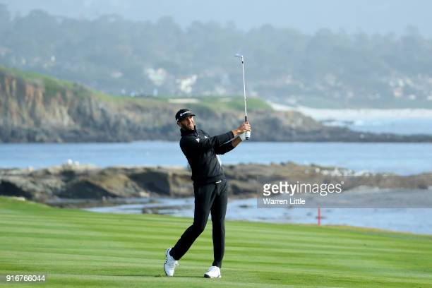Dustin Johnson plays his shot on the 18th hole during Round Three of the ATT Pebble Beach ProAm at Pebble Beach Golf Links on February 10 2018 in...