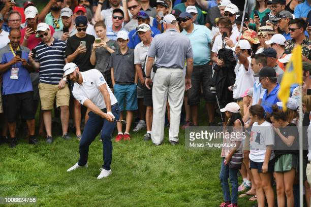 Dustin Johnson plays his shot out of the rough on the ninth hole during the third round at the RBC Canadian Open at Glen Abbey Golf Club on July 28,...