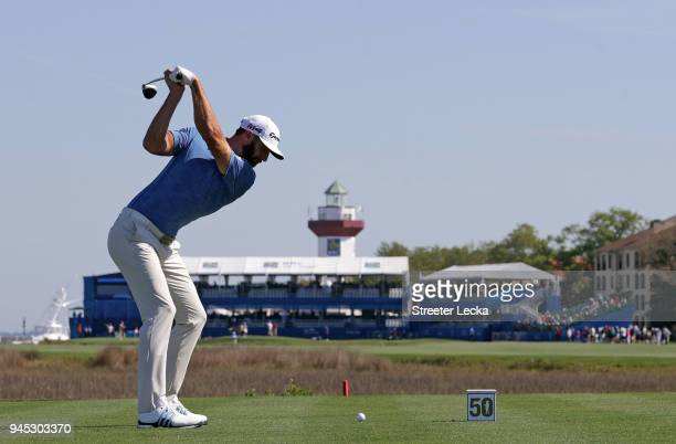 Dustin Johnson plays his tee shot on the 18th hole during the first round of the 2018 RBC Heritage at Harbour Town Golf Links on April 12 2018 in...