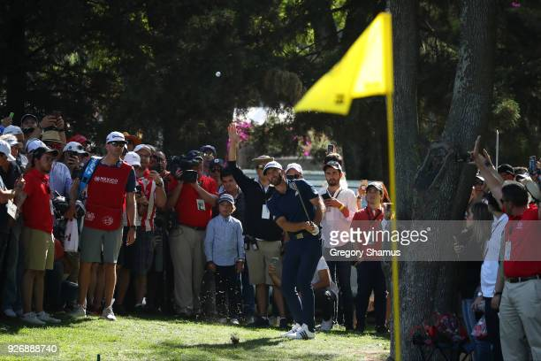 Dustin Johnson plays his third shot to the 15th green during the third round of World Golf ChampionshipsMexico Championship at Club de Golf...