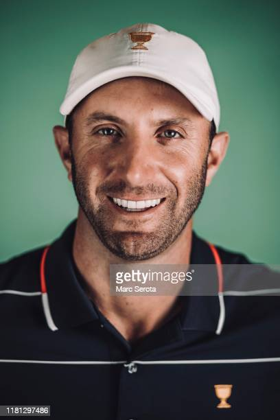 Dustin Johnson poses for photos for the upcoming Presidents Cup Tournament prior to the start of the TOUR Championship at East Lake Golf Club on...