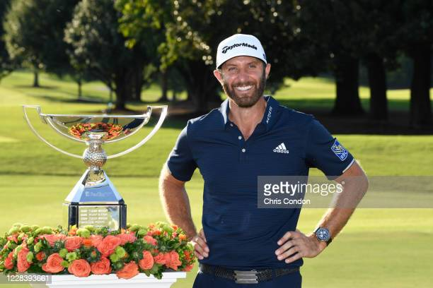 Dustin Johnson poses with the FedExCup after winning the TOUR Championship at East Lake Golf Club on September 7 2020 in Atlanta Georgia