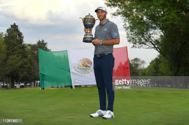 Dustin Johnson poses with the Gene Sarazen Cup after winning during the final round of the World Golf Championships-Mexico Championship at Club de...