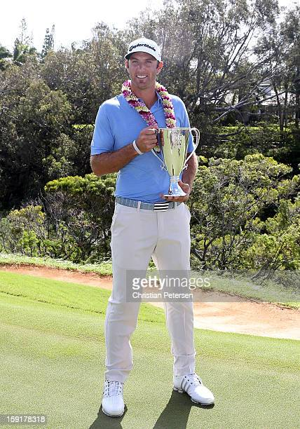 Dustin Johnson poses with the Hyundai Tournament of Champions Cup after winning in the final round at the Plantation Course on January 8, 2013 in...