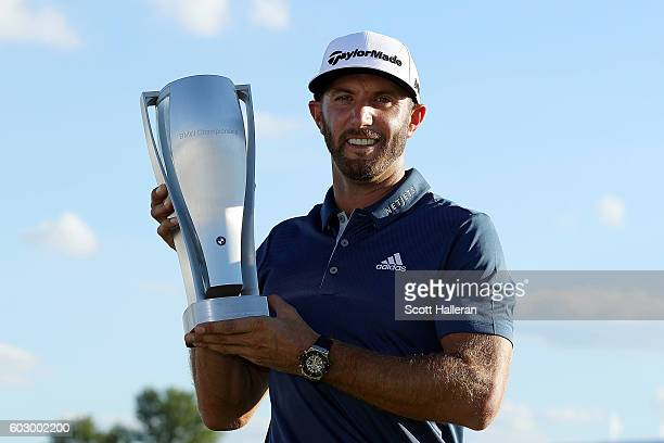 Dustin Johnson poses with the trophy after his three stroke victory at the BMW Championship at Crooked Stick Golf Club on September 11 2016 in Carmel...