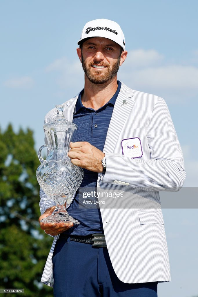 Dustin Johnson poses with the trophy after the final round of the FedEx St. Jude Classic at TPC Southwind on June 10, 2018 in Memphis, Tennessee.