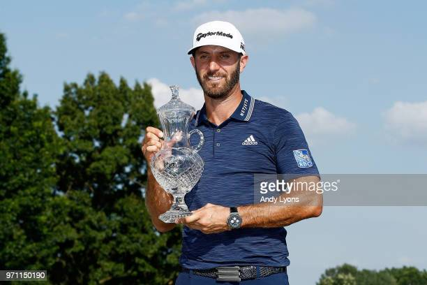 Dustin Johnson poses with the trophy after the final round of the FedEx St Jude Classic at TPC Southwind on June 10 2018 in Memphis Tennessee