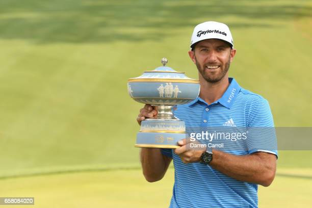 Dustin Johnson poses with the trophy after winning the World Golf Championships-Dell Technologies Match Play at the Austin Country Club on March 26,...