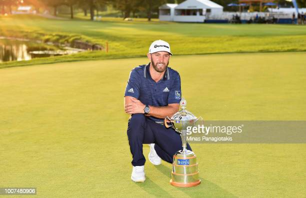 Dustin Johnson poses with the trophy during the final round at the RBC Canadian Open at Glen Abbey Golf Club on July 29, 2018 in Oakville, Canada.