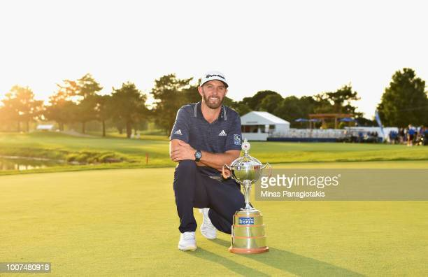 Dustin Johnson poses with the trophy during the final round at the RBC Canadian Open at Glen Abbey Golf Club on July 29 2018 in Oakville Canada