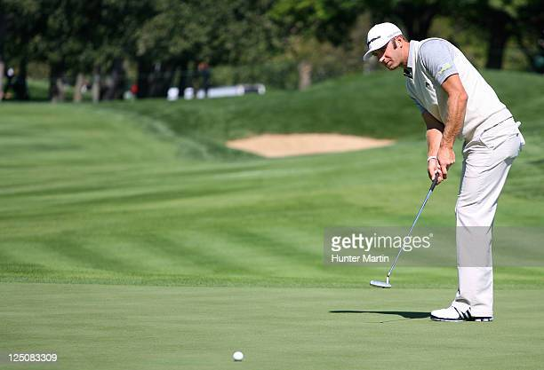 Dustin Johnson puts on the 16th green during the first round of the BMW Championship at Cog Hill Golf Country Club on September 15 2011 in Lemont...