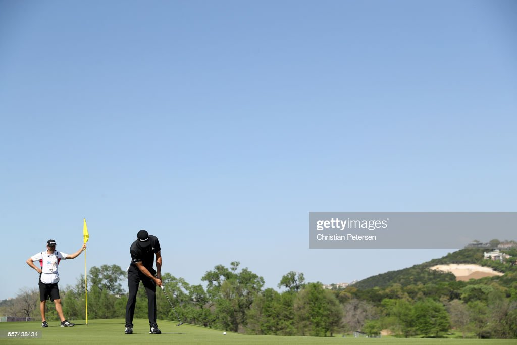 Dustin Johnson putts on the 14th hole of his match during round three of the World Golf Championships-Dell Technologies Match Play at the Austin Country Club on March 24, 2017 in Austin, Texas.