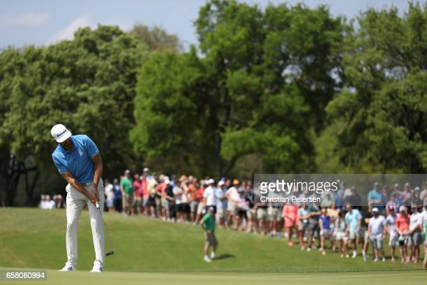 Dustin Johnson putts on the 1st hole during the final match of the World Golf Championships-Dell Technologies Match Play at the Austin Country Club...