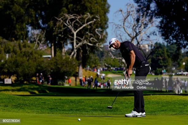 Dustin Johnson putts on the 4th Hole during the second round of the Genesis Open at the Riviera Country Club Golf Course on February 16, 2018 in...