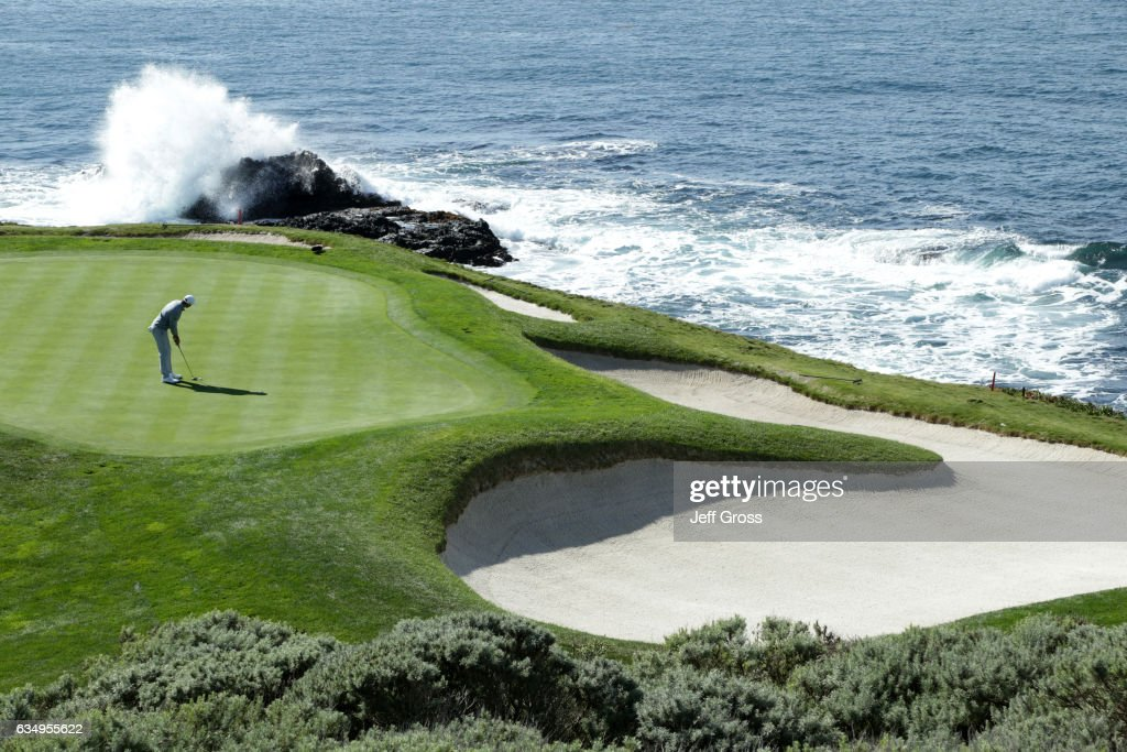 Dustin Johnson putts on the seventh hole during the Final Round of the AT&T Pebble Beach Pro-Am at Pebble Beach Golf Links on February 12, 2017 in Pebble Beach, California.
