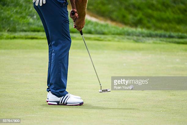 Dustin Johnson putts with his Scotty Cameron by Titleist Newport 2 putter on the 17th hole green during the first round of the Memorial Tournament...