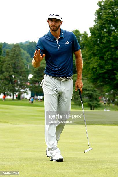 Dustin Johnson reacts after a birdie on the 17th green during the final round of the World Golf Championships - Bridgestone Invitational at Firestone...