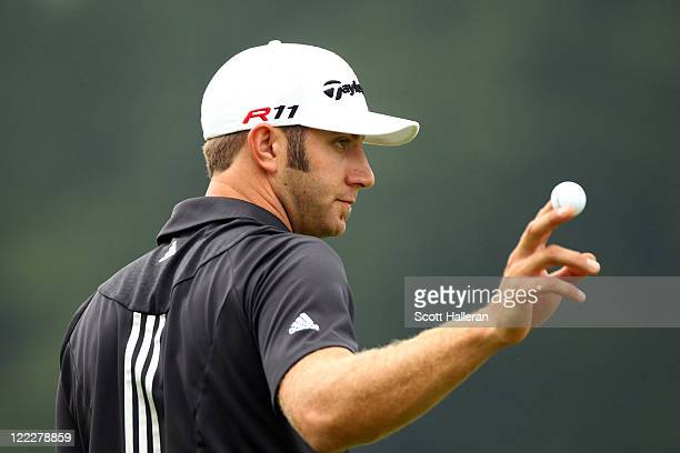 Dustin Johnson reacts after he made a birdie on the second hole during the third and final round of The Barclays at Plainfield Country Club on August...
