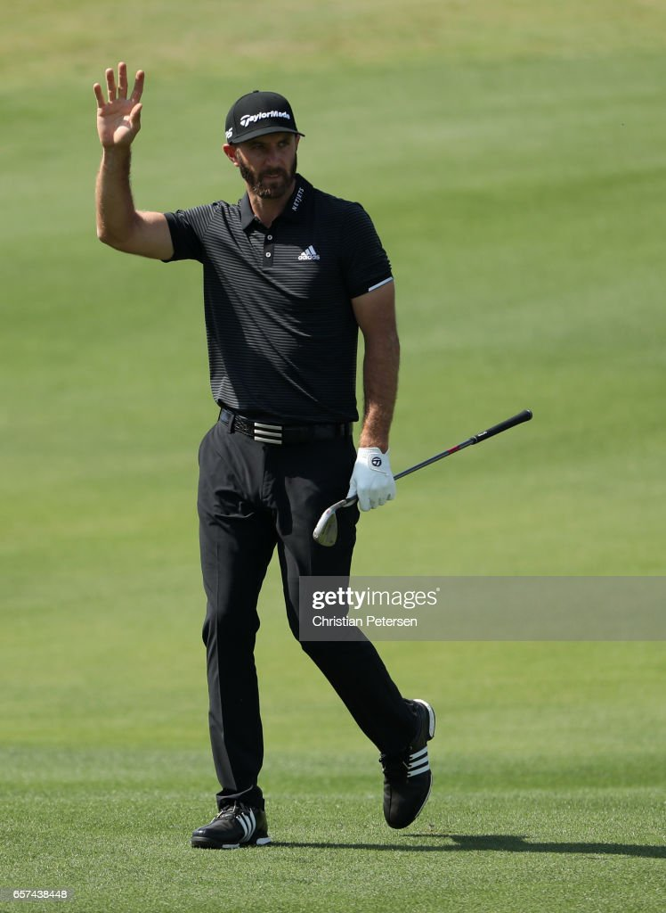 Dustin Johnson reacts after playing a shot on the 13th hole of his match during round three of the World Golf Championships-Dell Technologies Match Play at the Austin Country Club on March 24, 2017 in Austin, Texas.