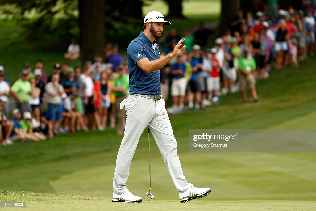 Dustin Johnson reacts on the 18th green after a putt during the final round of the World Golf Championships - Bridgestone Invitational at Firestone Country Club South Course on July 3, 2016 in Akron, Ohio.