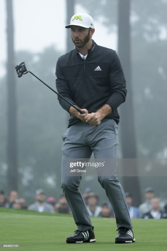 Dustin Johnson reacts to a missed birdie putt on the 18th green during Round Two of the AT&T Pebble Beach Pro-Am at Spyglass Hill Golf Course on February 10, 2017 in Pebble Beach, California.