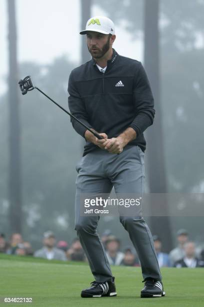 Dustin Johnson reacts to a missed birdie putt on the 18th green during Round Two of the AT&T Pebble Beach Pro-Am at Spyglass Hill Golf Course on...
