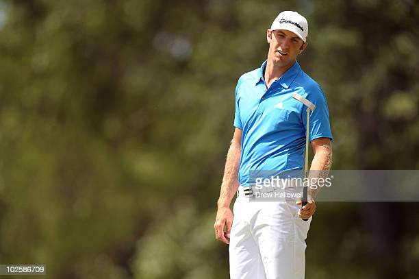 Dustin Johnson reacts to a putt attempt on the second hole during the second round of the AT&T National at Aronimink Golf Club on July 2, 2010 in...